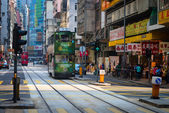 Electric trolleys and motor vehicles on a typical downtown stree — Stockfoto