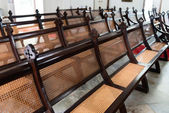 Rows of Antique, Handcrafted Pews in an Old Church — Stock Photo