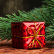 Branch of Christmas tree with gift box — Stock Photo #59906387