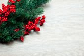 Branch of Christmas tree on a wooden surface — Foto Stock