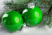 Branch of Christmas tree with decoration ball — Stock Photo