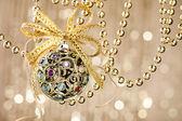 Christmas ball on shiny background — Stock Photo