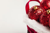 Christmas decorations on red basket — Стоковое фото