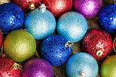 Many colored Christmas balls on the background — Стоковое фото