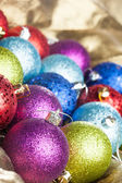 Many colored Christmas balls on the background — Stockfoto