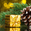 Branch of Christmas tree with gift box — Stock Photo #59911061