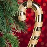 Golden candy cane on shiny background — Stock Photo #59911259