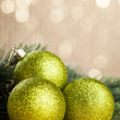 Branch of Christmas tree with decoration ball — Stock Photo #59911347
