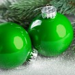 Branch of Christmas tree with decoration ball — Stock Photo #59911393