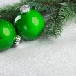 Branch of Christmas tree with decoration ball — Stock Photo #59911445