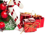 European holly with candy cane and gift box  — Stockfoto
