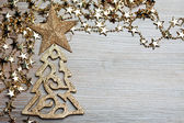 Fir-tree with star on wooden background — Stockfoto