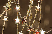 Christmas stars on sparkles background — Stockfoto
