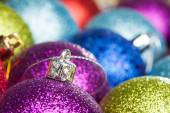 Many colored Christmas balls on the background — Stock Photo