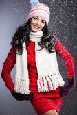 Beautiful fashionable woman with snow — Stock Photo