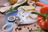 Fish on wooden kitchen board — Stock Photo