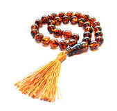 Baltic amber islamic rosary isolated on white — Stock Photo