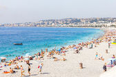 Tourists in the beach in Nice, France — Stock Photo