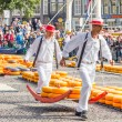 Постер, плакат: ALKMAAR THE NETHERLANDS SEPTEMBER 7: Carriers walking with ma