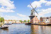 Typical windmill and medieval architecture in Haarlem, The Netherlands — Stock Photo