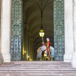 Постер, плакат: Swiss guard in Vatican building entrance