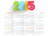 Yearly 2015 calendar with colorful text. — Vector de stock