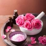 Spa set with rose flowers mortar essential oils salt — Stock Photo #52028853