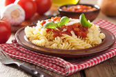 Italian pasta fusilli with tomato sauce and basil — Stock Photo