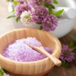 Spa with purple herbal salt and clover flowers — Stock Photo #55189837