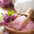 Spa with pink herbal salt and clover flowers — Stock Photo #55189855