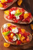 Italian bruschetta with tomatoes garlic olive oil  — Stock Photo