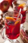 Glass of mulled wine with orange and spices, christmas decoratio — Stock Photo