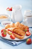Fresh croissants with jam and strawberry for breakfast — Stock Photo