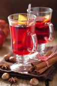Glass of mulled wine with orange and spices, winter drink — Stock Photo
