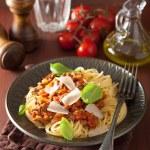 Italian pasta spaghetti bolognese with basil on rustic table — Stock Photo #66200221
