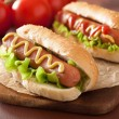 Hot dog with ketchup mustard and lettuce — Stock Photo #68362139