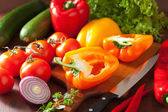 Chopping healthy vegetables pepper tomato salad onion chili on r — Stock Photo