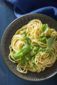 Spaghetti pasta with pesto sauce over blue — Φωτογραφία Αρχείου