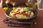 Italian pasta spaghetti bolognese with basil on rustic table — Stockfoto