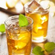 Glass of ice tea with lemon and melissa — Stock Photo #73641079