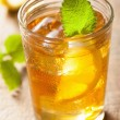 Glass of ice tea with lemon and melissa — Stock Photo #73641091