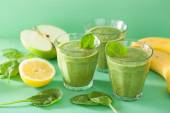 Healthy green smoothie with spinach leaves apple lemon banana — Stock Photo