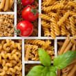 Various raw wholegrain pasta in white wooden box — Stock Photo #74853343