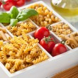 Various raw wholegrain pasta in white wooden box — Stock Photo #74853393