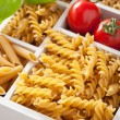 Various raw wholegrain pasta in white wooden box — Stock Photo #74853413