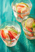 Refreshing summer drink with strawberry cucumber lime in glasses — Stock Photo