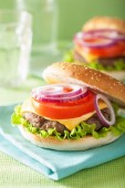 Burger with beef patty cheese lettuce onion tomato — Stockfoto
