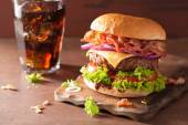 Bacon cheese burger with beef patty tomato onion cola — Stock Photo