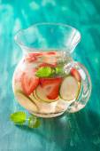 Refreshing summer drink with strawberry cucumber lime in jar — Stock Photo