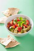 Avocado strawberry salsa with tortilla chips — Stock Photo